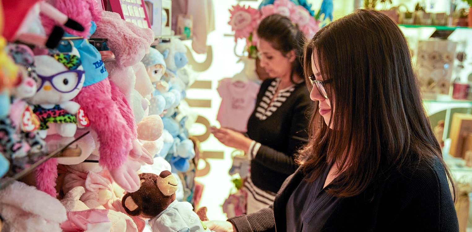 Women browse stuffed animal selection in the hospital's gift shop