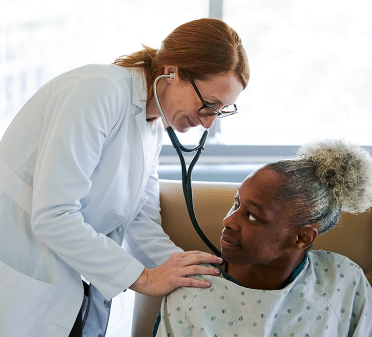 A doctor listening to a patient's breathing