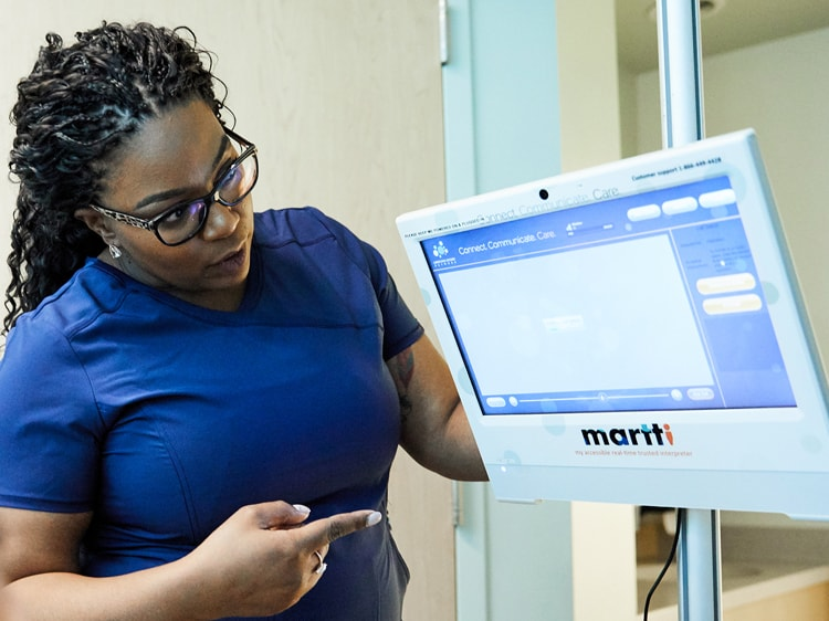 Nurse using telemedicine device