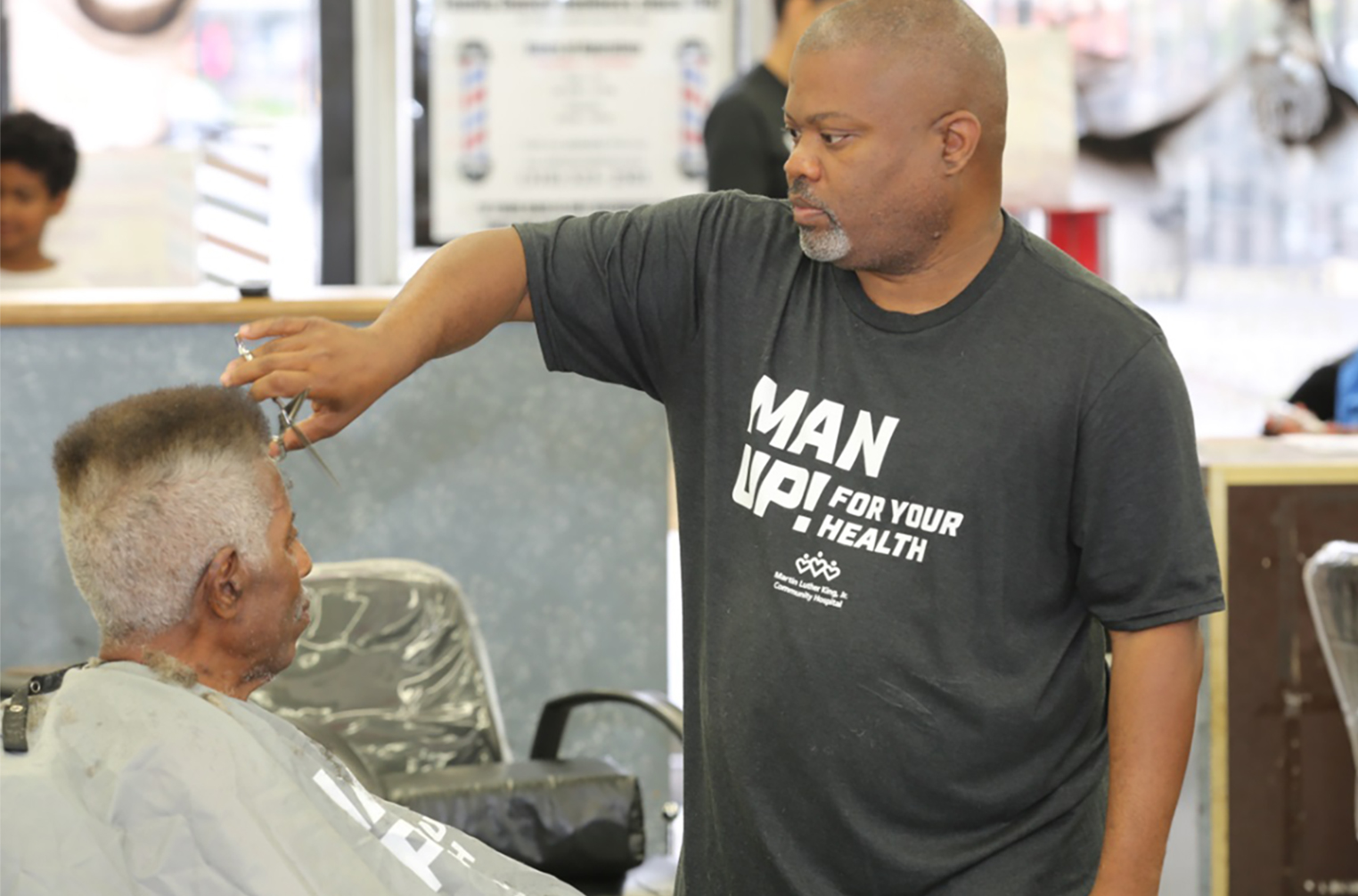 Barber Darryl Jones with a client
