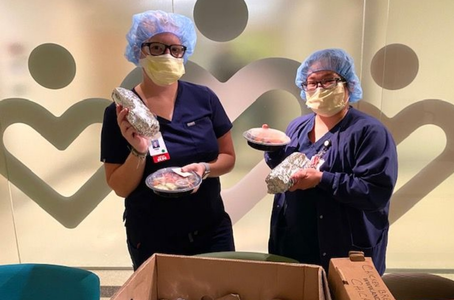 Nurses with donated sandwiches