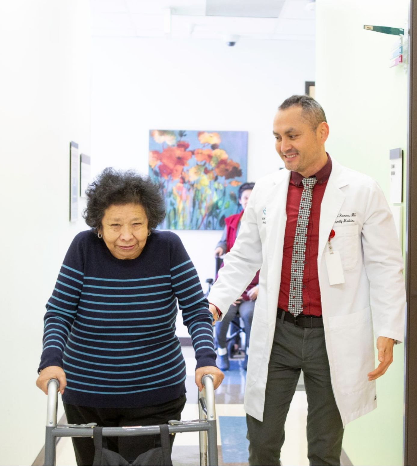 Photo of Dr. Romero with a patient